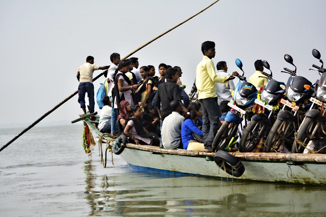 People travel to Berhampura, an island on Chilika.