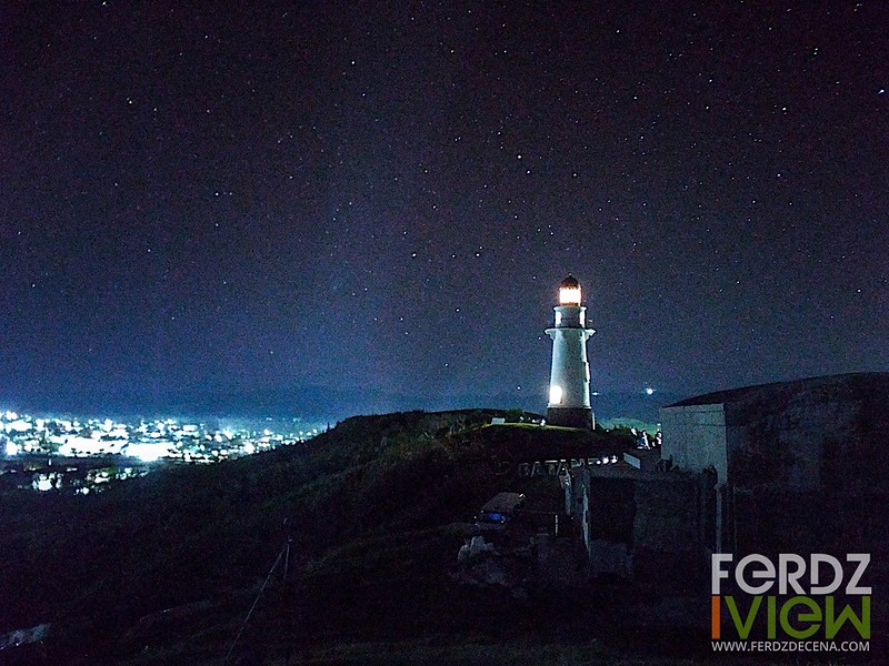 Basco lighthouse and town lights