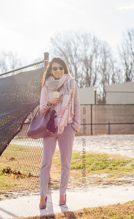 pink striped blanket scarf, lilac pink leather jacket, pale pink sweater, light gray pants, gray tote, gray suede pumps