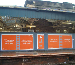 Nework Rail electrification hoardings at Newport station
