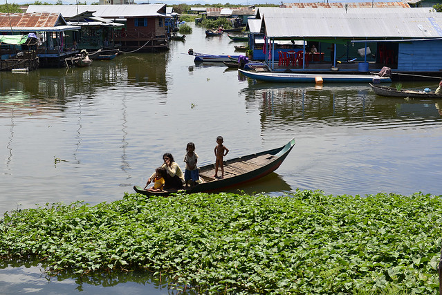 Woman taking her kids along for a boat ride in Raing Til village, Pursat province, Cambodia. Photo by Sylyvann Borei.