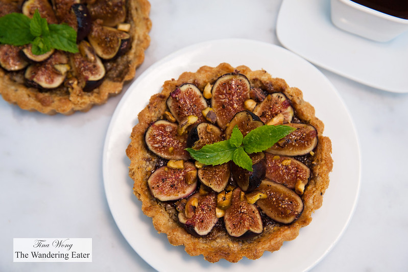Pistachio and fig tart - pistachio pâte brisée, pistachio-orange frangipane, California black mission figs glazed with black pepper honey