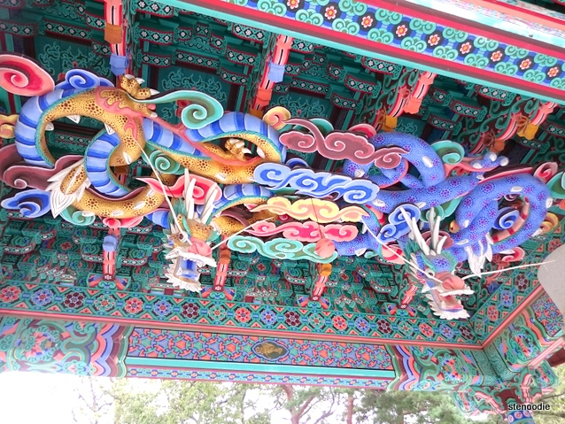 dragons on the ceiling of a temple roof