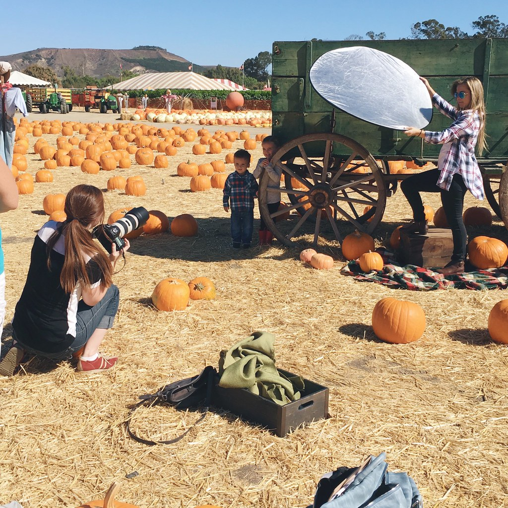 Behind the scenes at the pumpkin patch photo shoot