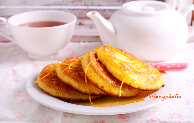 Orange pancakes on plate,