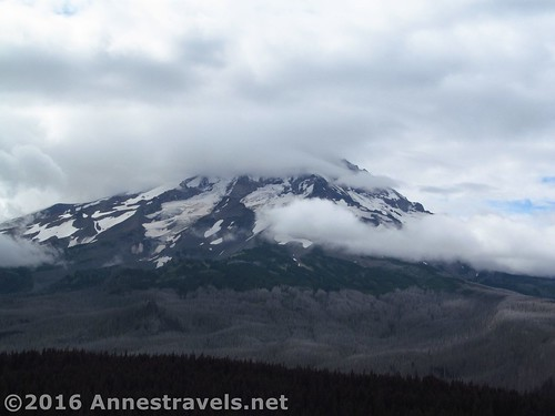 Clouds swirl around Mt. Hood as seen from Owl Point, Mount Hood National Forest, Oregon