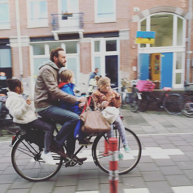 After school minivans #amsterdam style. Complete with snacks, friends, a chauffeur and fresh fall air. #urbancycling #bicycle #dutchbikes #kidsonbikes