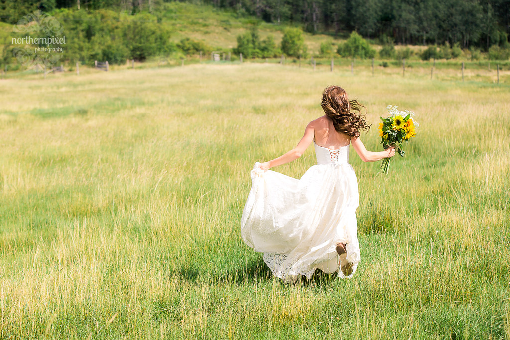 Running through the field - Smithers BC Wedding