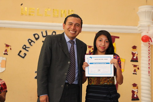 Samuel with a scholarship student at her graduation ceremony