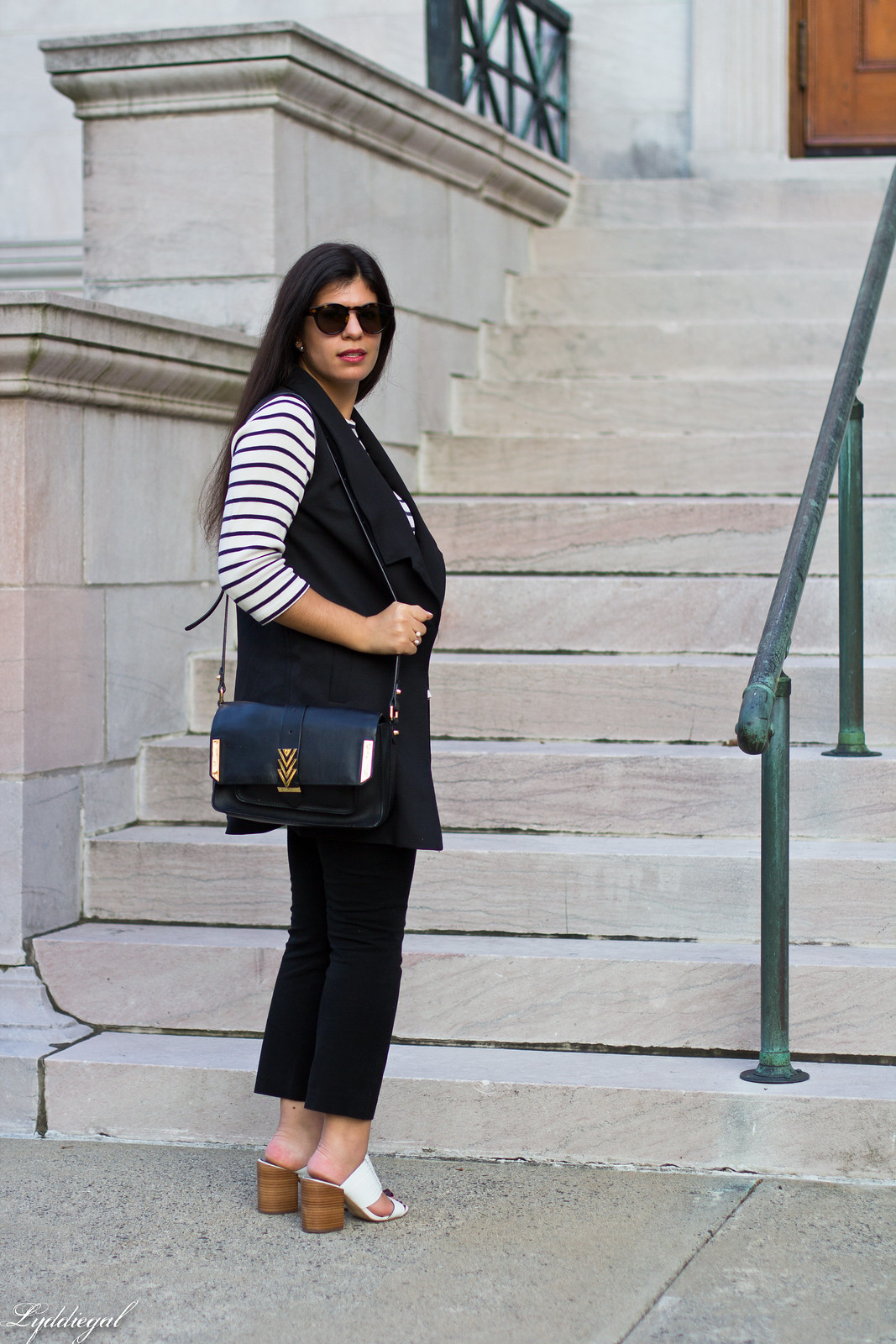 long black vest, striped shirt, white mules, black pants.jpg