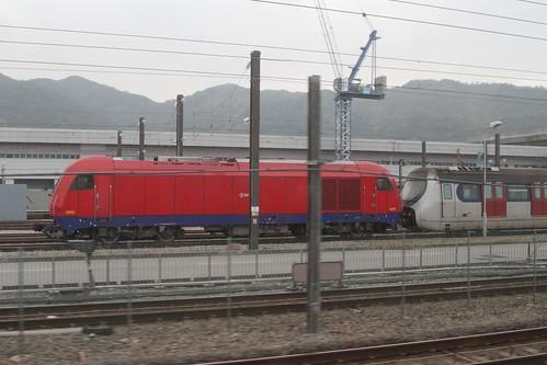 """MTR diesel #8005 (Siemens """"Eurorunner"""" model ER20) coupled to a SP1900 EMU at Pat Heung Depot"""