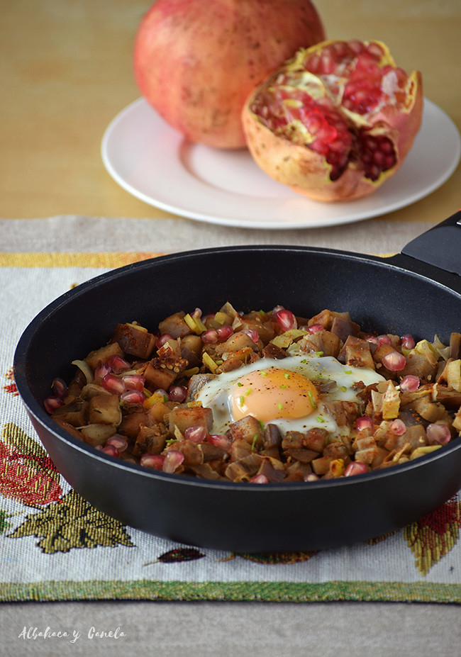 Eggplant with poached egg and pomegranate seeds