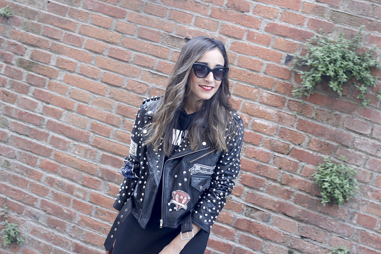 Leather jacket with studs and patches black skirt heels style fashion outfit18