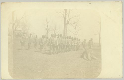 Uniformed men in a row