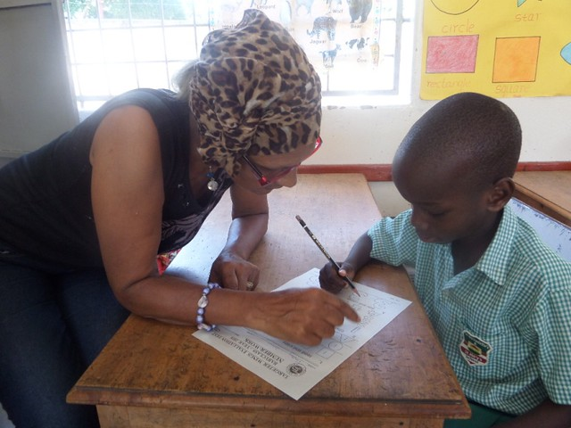 Waseema guides Timothy through his examination paper