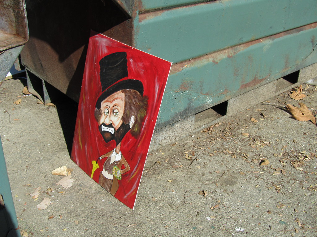 Still Life: Sad Clown with Dumpster