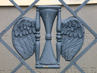 Wrought Iron Winged Hourglass (New Orleans, LA) | by takomabibelot