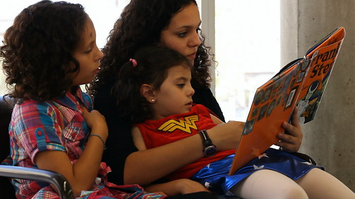 Glori Dei Filippone Reading with her Sisters at the LEED Certified Des Moines Public Library | by OurChildrensTrust