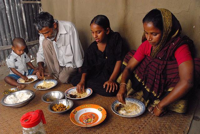 Eating fish and rice, Bangladesh. Photo by WorldFish, 2007