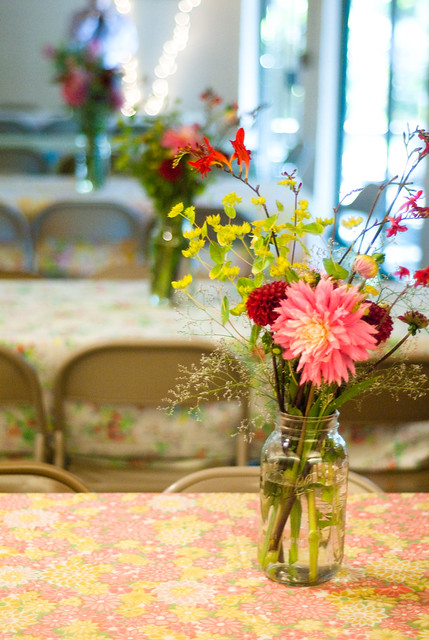Vintage sheet table cloths, 1/2 gallon mason jars, and flowers from the farmer's market