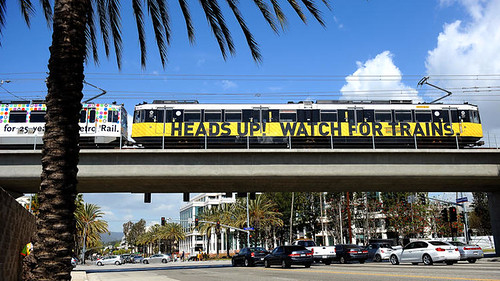 Heads up Watch for Trains banner on Expo Line light rail train, Los Angeles