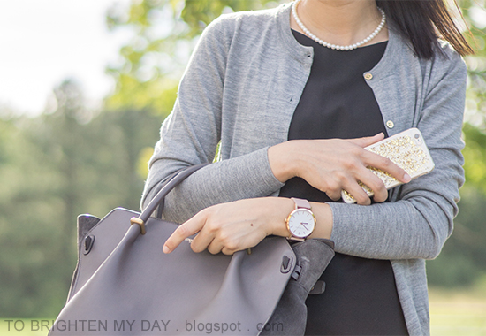 gray cardigan, black sleeveless shift dress, pearl necklace, oversized watch, gray tote