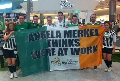 """Angela Merkel thinks we're at work"" flag: Irish football fans from the University of Limerick on their way to Euro 2012 at Dublin Airport. via @damomac #DontTellMerkel 