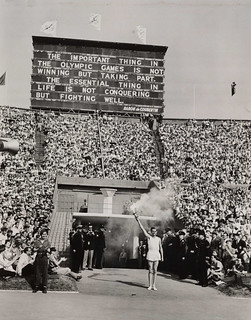 Torch-bearer arrives at opening ceremony, Olympic Games, London, 1948. | by National Media Museum