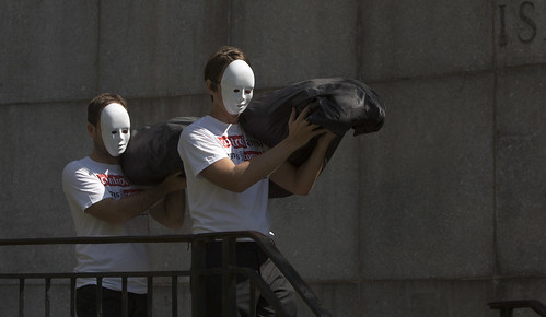 Control Arms Campaigners carry a body at the UN Arms Trade Treaty Conference, July 2012 | by Oxfam International