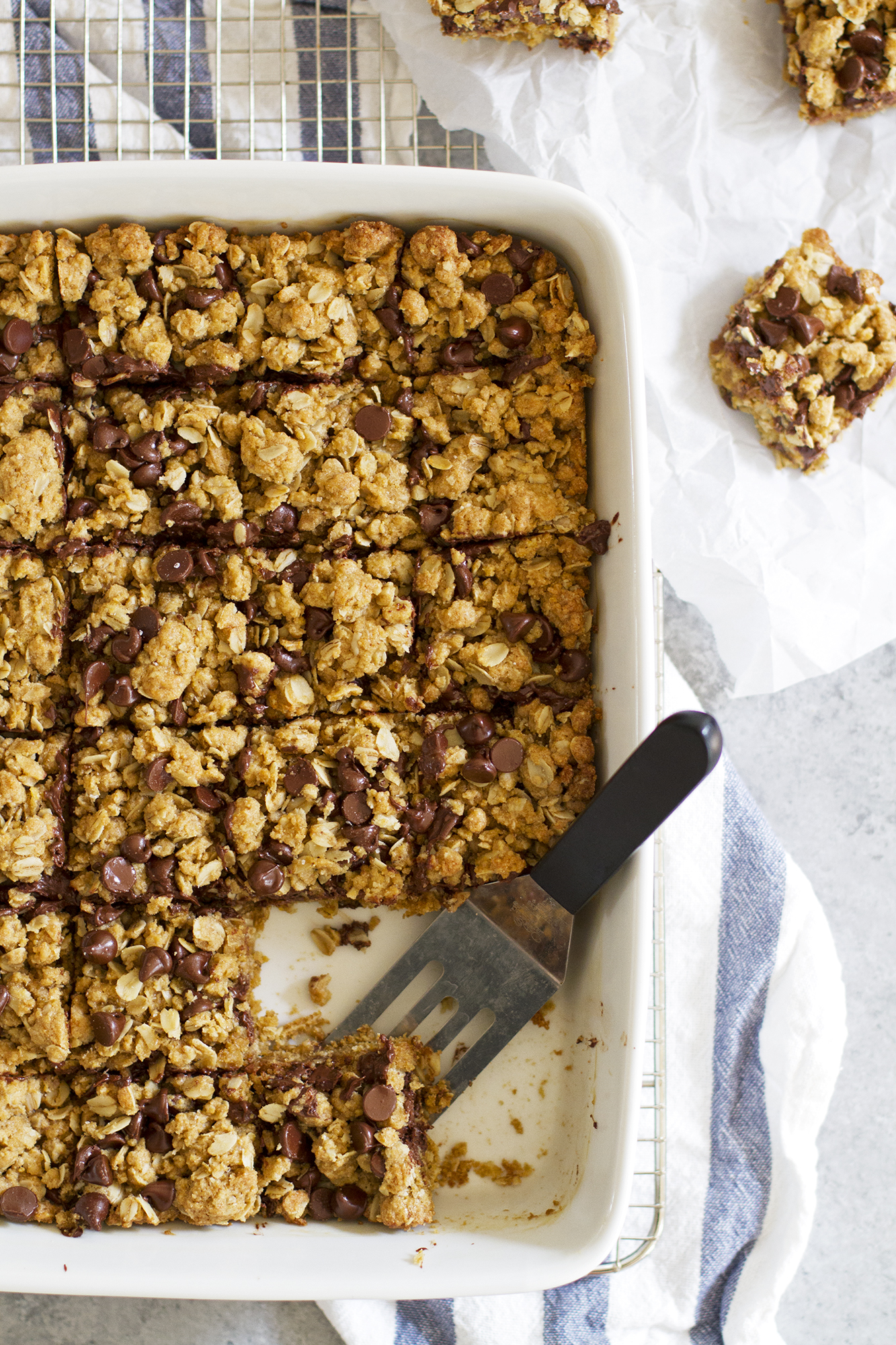 Whole Wheat Oatmeal Chocolate Chip Cookie Bars | girlversusdough.com @girlversusdough