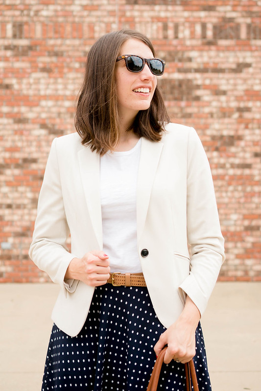 navy and white polka dot skirt + cognac bag + white tee + cream blazer; summer spring work outfit | Style On Target