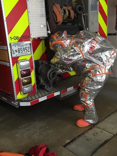 Not As Easy As It Looks - haz mat team member performing dexterity drill in Level A haz mat suit