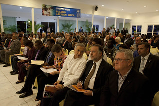 "Heraldo Munoz (in white) and SRSG Mariano Fernandez during the screening of ""Haiti Rebuilds: A Journey of Hope"" 