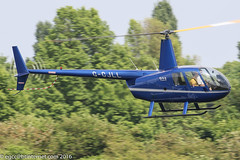 G-CJLL - 2007 build Robinson R44 Raven II, inbound to the pumps at Barton for fuel