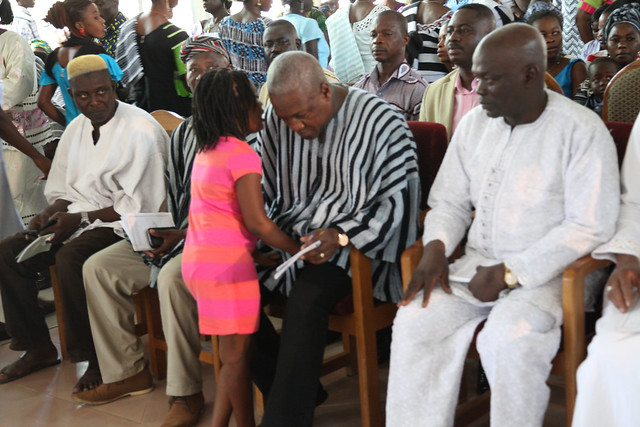 President John Mahama and his family spent the Easter weekend with the extended family and people of Bole in the Northern Region. Here, father and daughter (Farida) confer during the Easter Sunday church service at the Martyrs of Uganda Catholic Church in