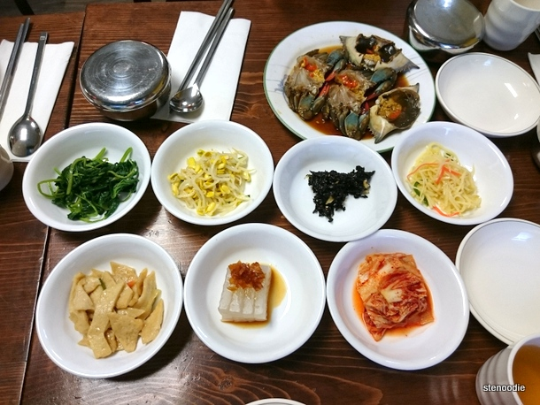 raw crabs and banchan