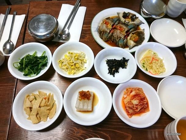 raw crabs and banchan