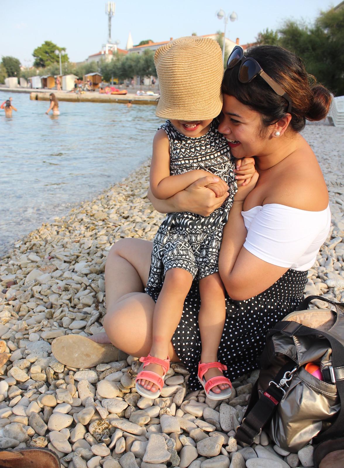 Playing on the beach in Supetar Croatia