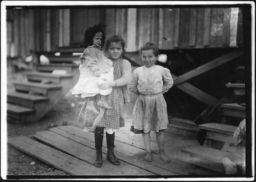 Millie, (about 7 years old) and Mary John (with baby) 8 years old. Both shuck oysters. This is Mary's second year, February 1911 | by The U.S. National Archives
