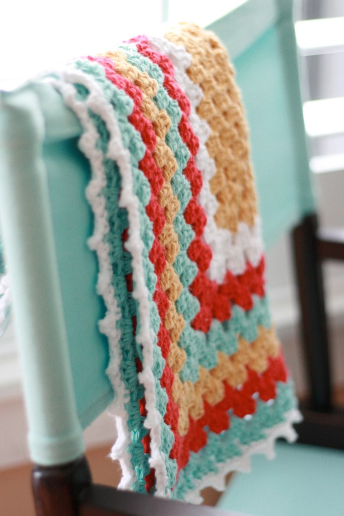 This granny square blanket uses a free crochet pattern and great colors to make a bold statement. Quick and easy to make, you won't want to miss this crochet blanket pattern from Daisy Cottage Designs.