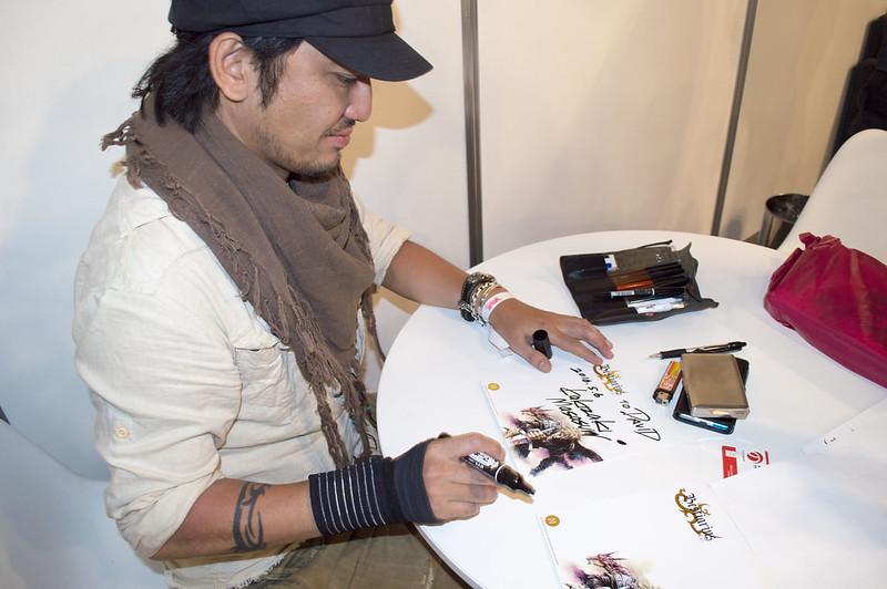 Masasumi Kakizaki firmandonos