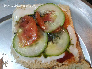 Place cucumber slices and tomato slices