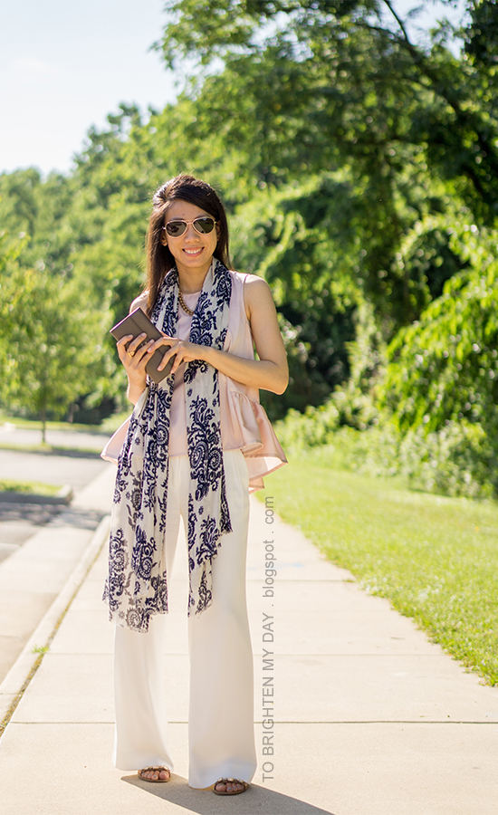 blue floral scarf, gold jewelry, pink peplum top, taupe clutch, white wide-legged trousers, jeweled block sandals