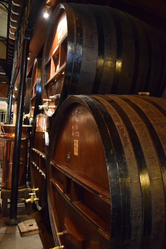 Barrels in the Denoix Distillery, Brive | www.rachelphipps.com @rachelphipps