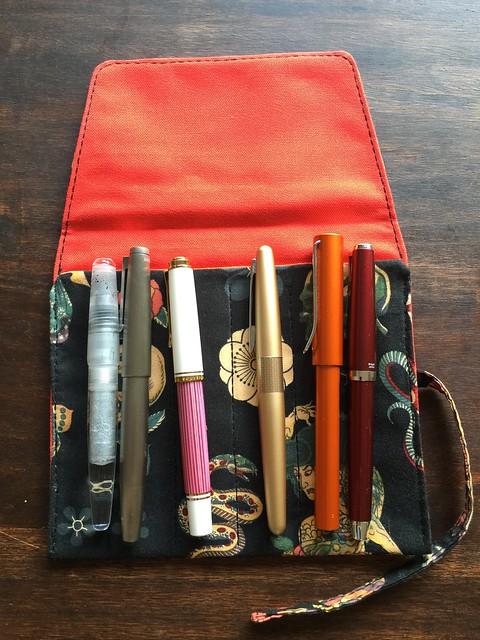 Pen wrap with pens