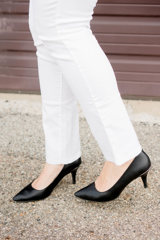 white jeans + black patterned blouse + heels; summer work outfit | Style On Target