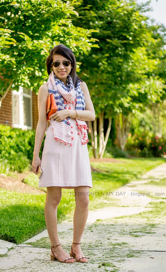 striped and pom pom scarf, pink sleeveless wool dress, orange clutch, brown jeweled sandals
