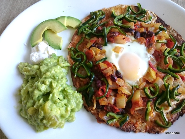 Huevos Rancheros with poblano peppers, sour cream, and tomatillo guacamole