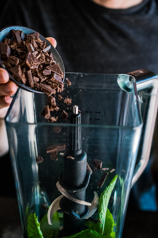 adding semi-sweet chocolate chunks to the blender