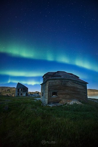 """Warp Zone"" Aurora over the abandoned, twisted Hudson Bay buildings of Hebron. The second I saw images of that remote, nearly deserted Moravian mission (only one family remains), I knew I wanted to photograph it at night. Big thanks to The Torngats Base C"